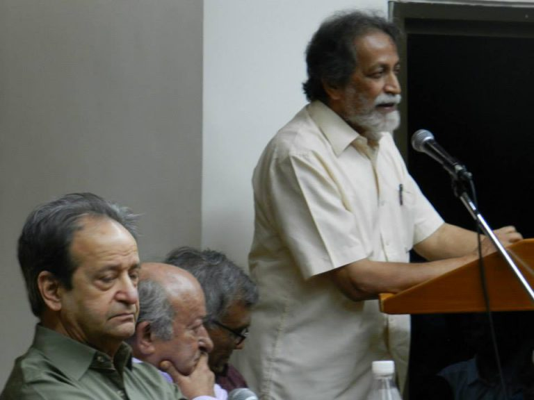 Prabhat Patnaik speaking at the book launch of Marx, Gandhi and Modernity: Essays presented to Javeed Alam (edited by Akeel Bilgrami), Delhi, July 2014; (seated, left to right) Aijaz Ahmad, Javeed Alam and Gopal Guru